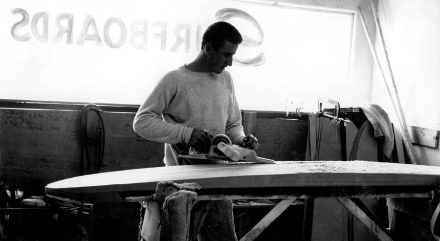 Larry Gordon Shapes A Balsa Wood Surfboard In 1960.