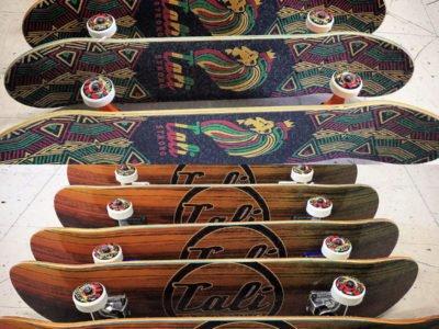 CALI Strong Rasta Wood Skateboard Trick