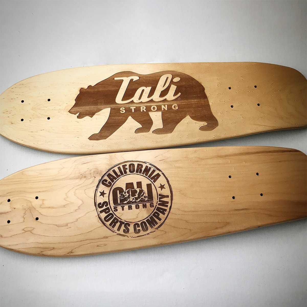 Which engraved woodwork skateboard design do you like best?