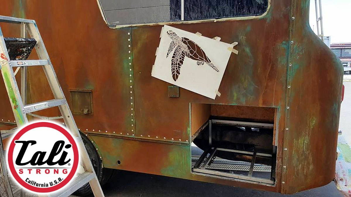 CALI Strong's New Mobile Retail Truck features rusted and patina finish with sea animals.
